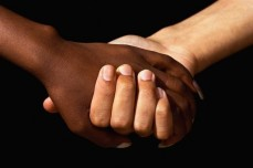 interracial_hands-585x390